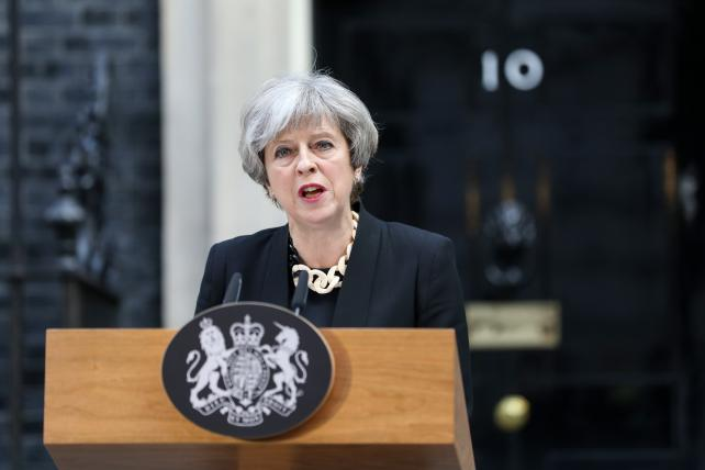 U.K. Prime Minister Theresa May delivers a statement outside number 10 Downing Street following the terror attack in London on Sunday.