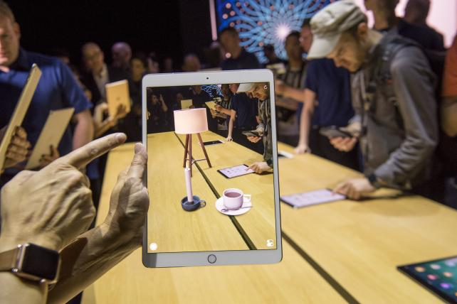 An attendee demonstrates the ARKit augmented reality tool on an Apple iPad Pro during the Apple Worldwide Developers Conference in San Jose, Calif., on June 5.