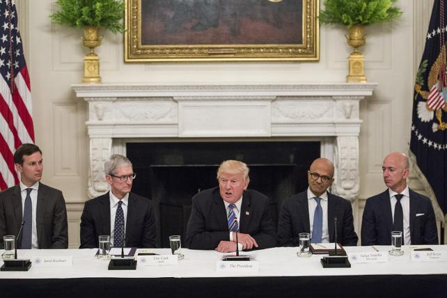 U.S. President Donald Trump, center, speaks with tech leaders during the American Technology Council roundtable hosted at the White House in Washington, D.C., U.S., on Monday, June 19, 2017.