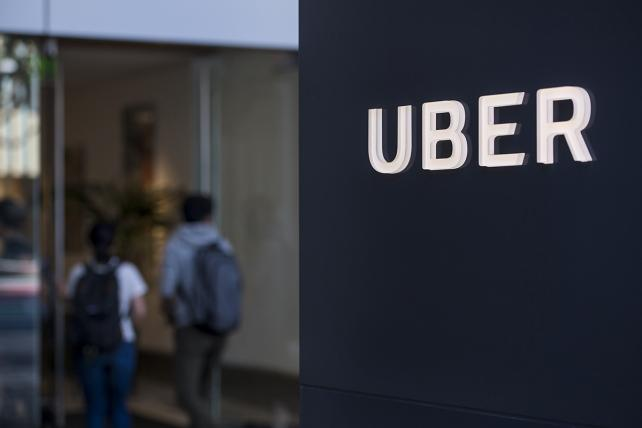 People enter the Uber Technologies Inc. headquarters building in San Francisco, California, U.S., on Wednesday, June 21, 2017.