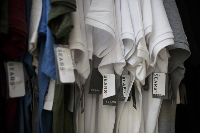 Tags hang from clothing displayed for sale at a Sears Canada Inc. store inside a mall in Toronto, Ontario, Canada, on Thursday, June 22, 2017.