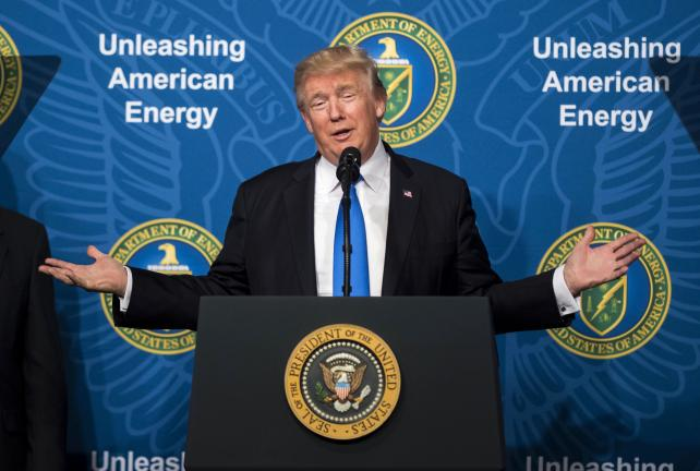 President Donald Trump speaks during the Unleashing American Energy event at the Department of Energy in Washington, D.C., on Thursday. Trump said he is lifting an Obama-era policy that curtailed the financing of coal-fired power plants overseas, as he se