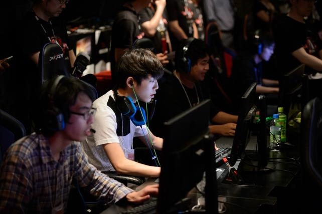 Attendees play Activision Blizzard Inc.'s Overwatch computer game at the AOC Open e-Sports event in Tokyo, Japan, on Saturday, July 1, 2017