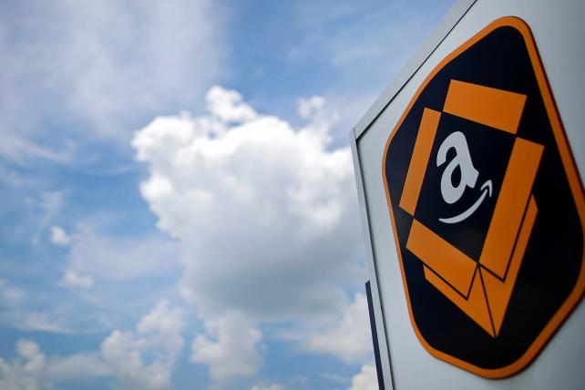 The Amazon logo is displayed outside the company's fulfillment center in Kenosha, Wisconsin, on Tuesday, Aug. 1, 2017.