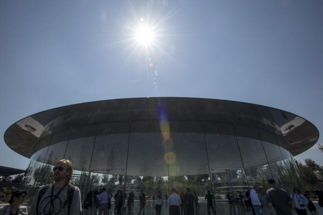 Attendees exit the Steve Jobs Theater on the Apple campus after an event in Cupertino, California, on Tuesday.