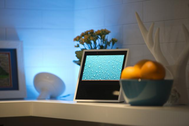 The Amazon Echo Show sits on display during the company's product reveal launch event in Seattle last September. Amazon and Microsoft are working to let their voice-activated assistants, which have different specialties, talk to one another.