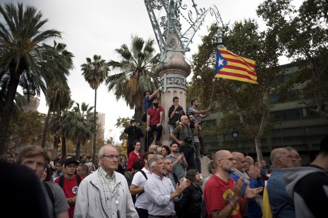 Pro-Catalan separatists wave a Catalan flag in Barcelona.