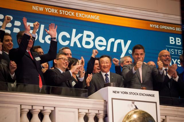 John Chen, executive chairman and chief executive officer of BlackBerry Ltd., center, rings the opening bell during the company's listing migration to the New York Stock Exchange (NYSE) in New York, U.S., on Monday, Oct. 16, 2017.