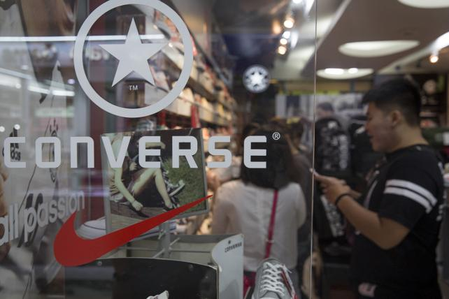 The Converse Inc. and Nike Inc. logos are displayed in a store window in Bangkok, Thailand, on Saturday, Oct. 21, 2017.
