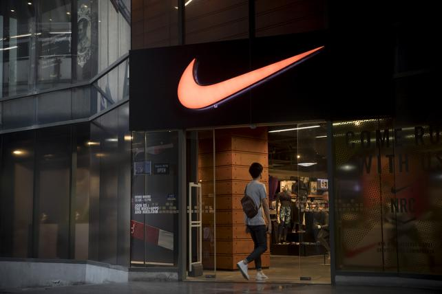 A man enters a Nike Inc. store in Bangkok, Thailand, on Saturday, Oct. 21, 2017.
