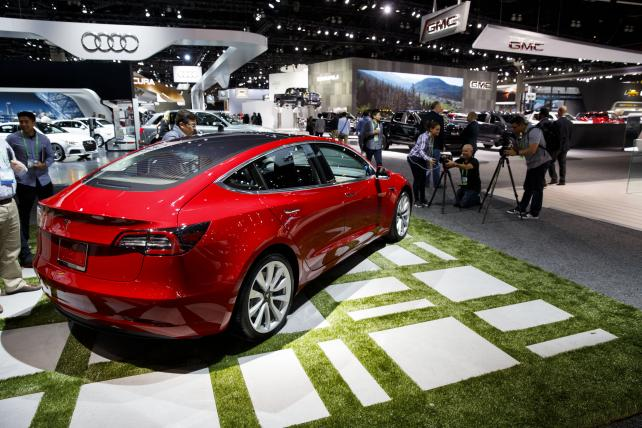 A Tesla Inc. Model 3 stands on display during AutoMobility LA ahead of the Los Angeles Auto Show in Los Angeles, on Nov. 30, 2017.