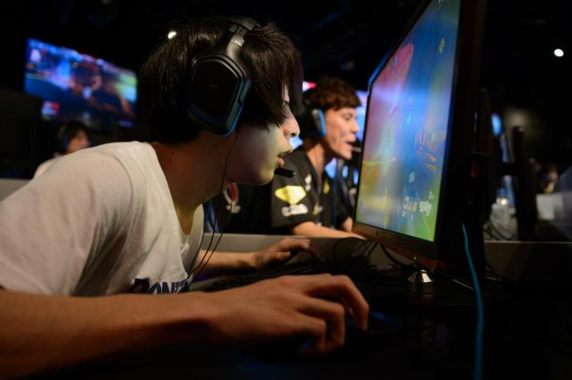 Attendees play Activision Blizzard's Overwatch computer game at the AOC Open esports event in Tokyo, Japan, on Saturday, July 1, 2017.