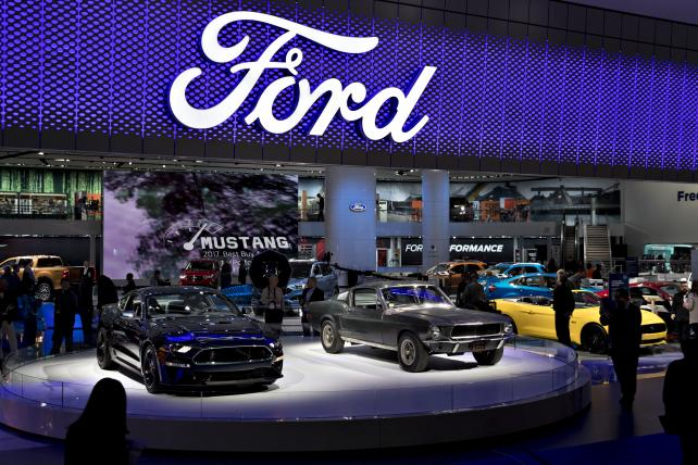 The 2019 Ford Motor Co. Mustang Bullitt sports vehicle, left, and 1968 Ford Mustang GT 390 vehicle, center, are displayed during the 2018 North American International Auto Show (NAIAS) in Detroit, Michigan, U.S., on Tuesday, Jan. 16, 2018.