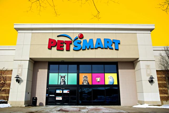 Signage is displayed outside of a PetSmart Inc. store in Yorkville, Illinois, U.S., on Tuesday, Feb. 6, 2018