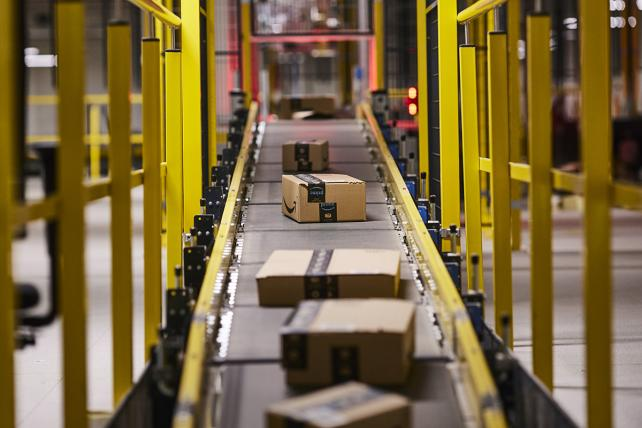 Amazon packages move along an automated conveyor belt at Amazon's new fulfillment center in Kolbaskowo, Poland, on Friday, Feb. 16.