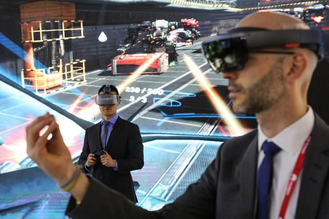 Attendees wear virtual reality headsets at the Huawei Technologies Co. pavilion during the Mobile World Congress.