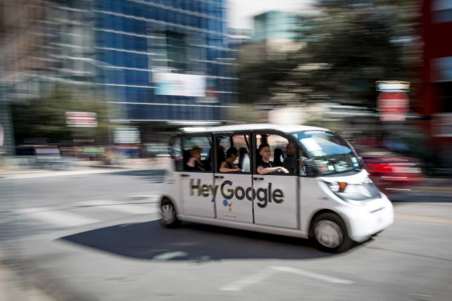 An electric car with a 'Hey Google' logo carries passengers during the South By Southwest (SXSW) conference in Austin, Texas, U.S., on Saturday, March 10, 2018.