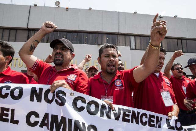Members of the National Union of Miners and supporters of Andres Manuel Lopez Obrador, presidential candidate of the National Regeneration Movement Party, shout slogans while Obrador officially registers his presidential candidacy on March 16.