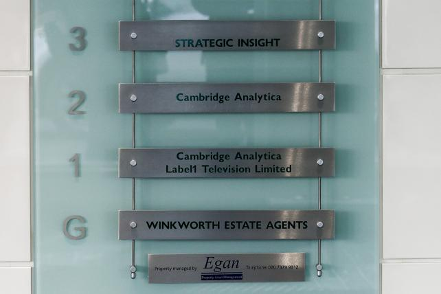 Labels list the occupants in the building that houses the offices of Cambridge Analytica in London.