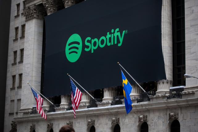 Spotify ends divisive artist policy after music-industry revolt