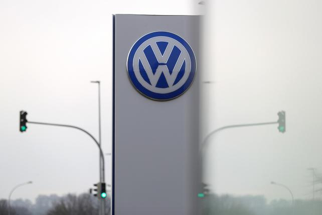 The Volkswagen logo sits on a sign at an entrance to the automaker's headquarters in Wolfsburg, Germany, on Friday, April 13, 2018.
