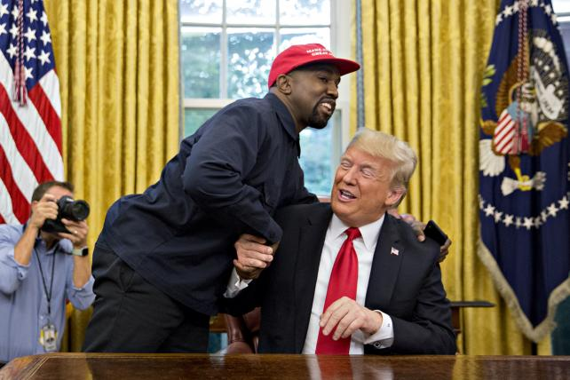 Rapper Kanye West, right, speaks as U.S. President Donald Trump, left, listens during a meeting in the Oval Office of the White House in Washington, D.C., U.S., on Thursday, Oct. 11, 2018