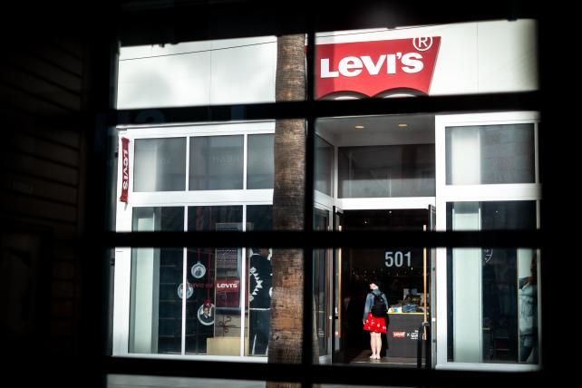 A shopper enters a Levi Strauss & Co. store on the Third Street Promenade in Santa Monica, California