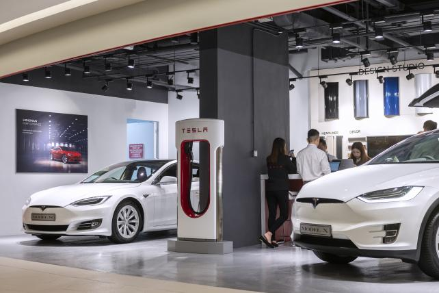 Tesla Inc. Model S, left, and Model X electric vehicles sit on display at a showroom in Hong Kong, China