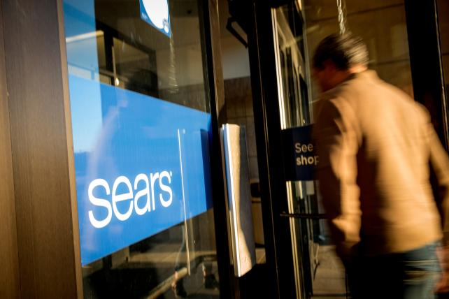 Lampert wins bid to keep Sears alive