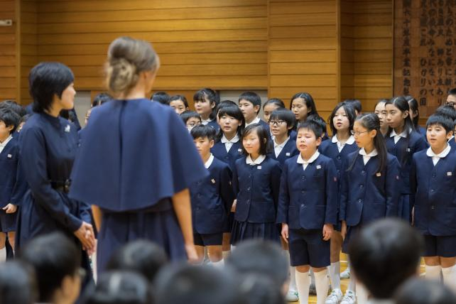 Melania Trump on the presidential trip to Japan, greeting a school group.