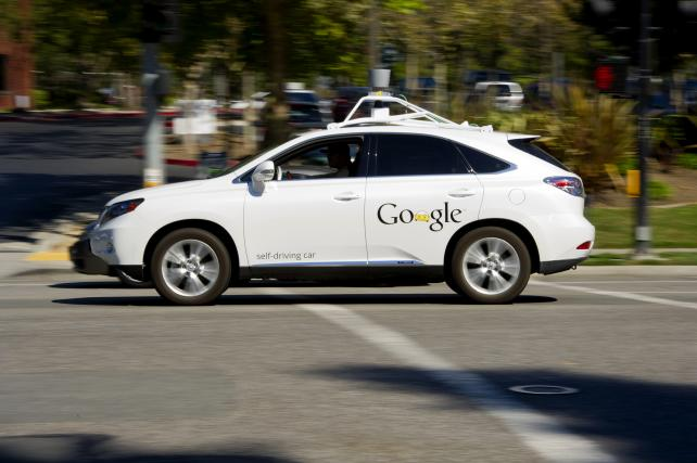 A Google self-driving car (human at the wheel) at company headquarters in Mountain View, Calif.