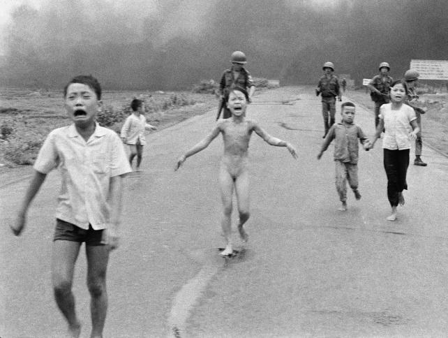 The June 8, 1972, file photo shows South Vietnamese forces following after terrified children, including 9-year-old Kim Phuc, center, as they run down Route 1 near Trang Bang after an aerial napalm attack on suspected Viet Cong hiding places.