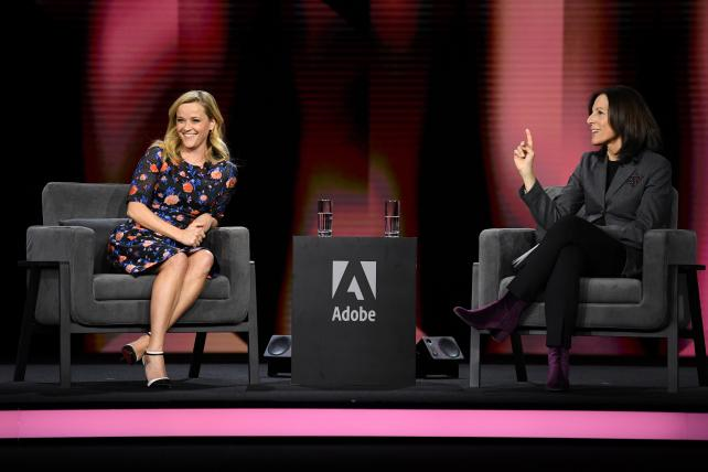 Ann Lewnes and Reese Witherspoon on stage during the Adobe summit keynote in Las Vegas