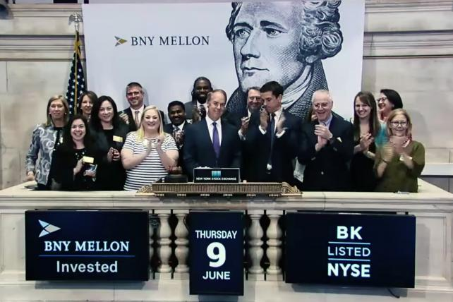 Ringing the bell at the New York Stock Exchange as part of the 'Invested in Our Legacy' campaign.