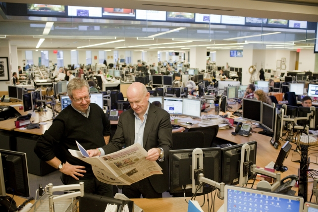 Journal Editor-in-Chief Gerard Baker, right, in the newsroom.