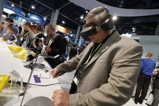 CES 2017 attendees test new technologies.
