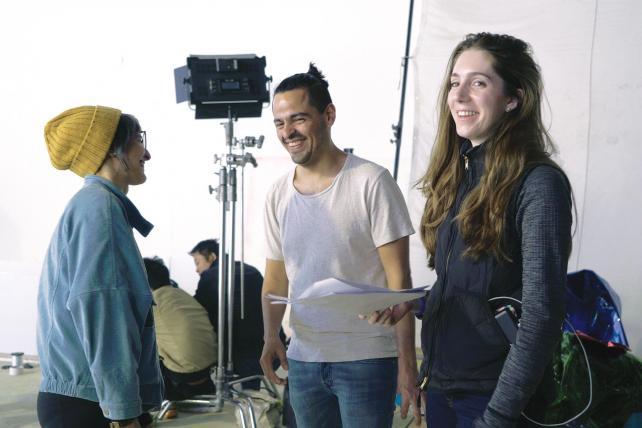 Relay's creative partner, Damian Velasco, center, and Greta Bradford, co-founder, right