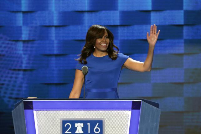 First Lady Michelle Obama greets the crowd ahead of her speech on the first night of the Democratic National Convention at the Wells Fargo Center in Philadelphia.