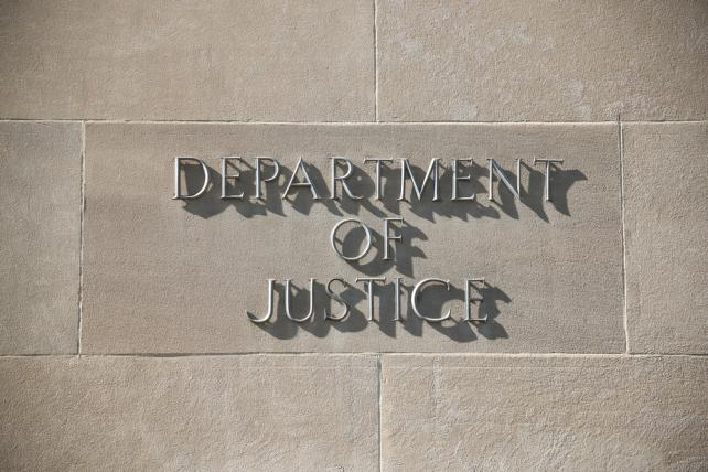 Five top holding companies say they are cleared in DOJ production probe