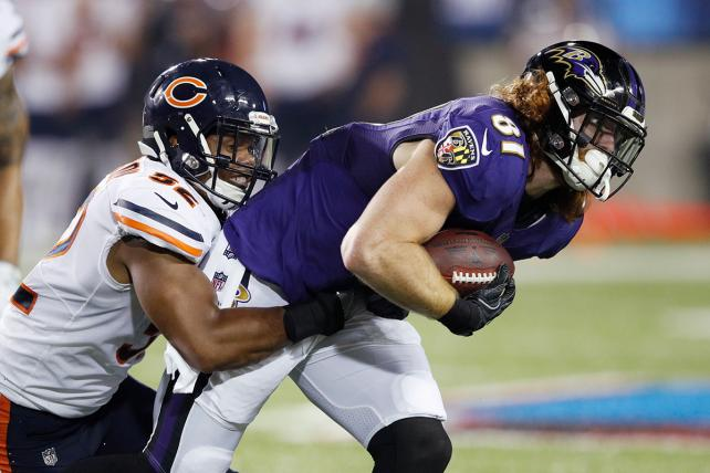 Hayden Hurst of the Baltimore Ravens makes a reception against Jonathan Anderson of the Chicago Bears on Aug. 2 in Canton, Ohio.