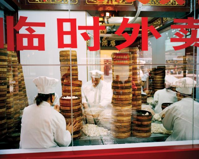 In Shanghai's Yu Gardens, chefs prepare hundreds of the city's famous 'xiao long bao' soup dumplings.