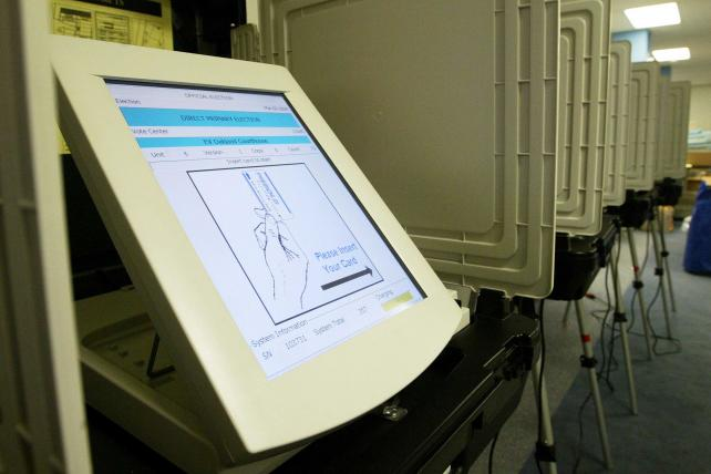 Digital voting machines, like this one from the Diebold company, are used in an Oakland, California polling location for an election.