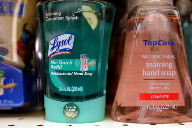 Bottles of antibacterial soap are seen on a grocery store shelf.