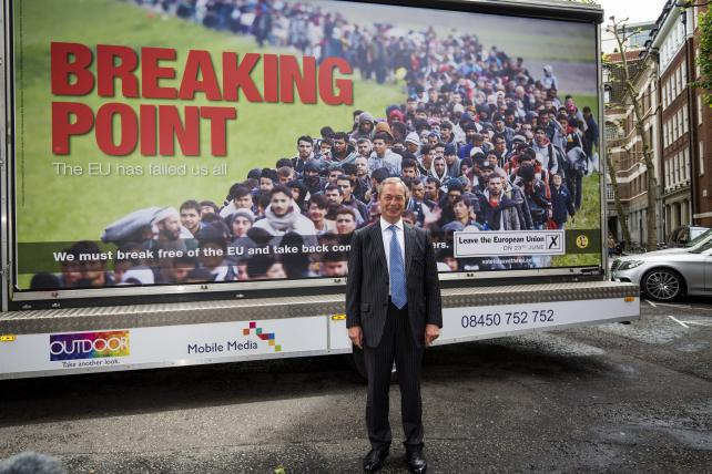 The leader of the United Kingdom Independence Party (UKIP), Nigel Farage, poses with the party's EU referendum poster in Westminster on June 16.