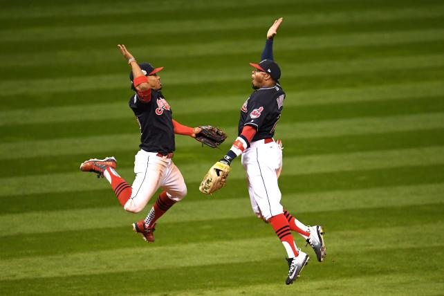 Francisco Lindor of the Cleveland Indians celebrates with Rajai Davis after defeating the Chicago Cubs 6-0 in Game 1 of the World Series on Tuesday.