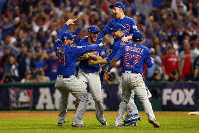 The Chicago Cubs celebrate defeating the Cleveland Indians in Game 7 of the 2016 World Series at Progressive Field on Wednesday, Nov. 2, 2016, in Cleveland.