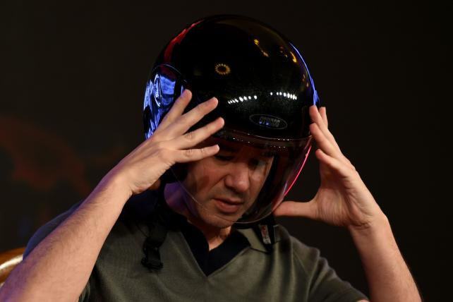 Co-founder and CEO of Uber Travis Kalanick wears a helmet as he speaks at an event in New Delhi on Dec. 16, 2016.