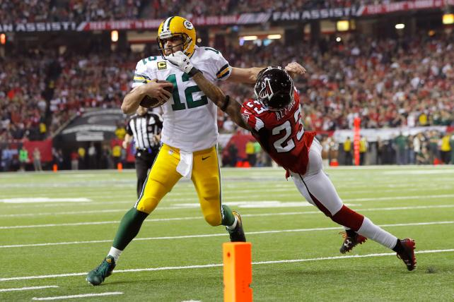 The Falcons' Robert Alford tries to tackle the Packers' Aaron Rodgers in the NFC Championship Game in January.