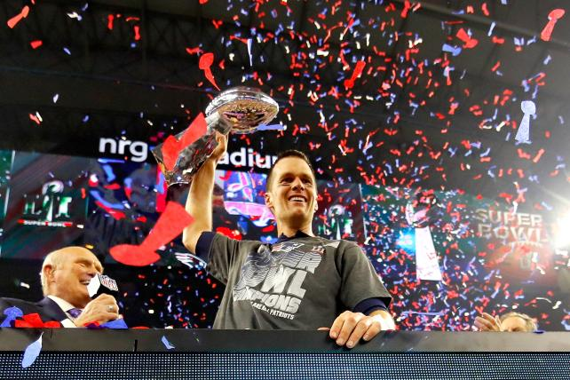 Tom Brady of the New England Patriots celebrates after defeating the Atlanta Falcons during Super Bowl 51 in Houston last February.