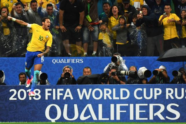 Brazil's forward Neymar celebrates after scoring against Paraguay during their 2018 FIFA World Cup qualifier football match in Sao Paulo, Brazil on March 28, 2017.